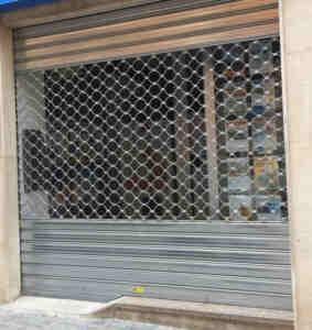puerta enrollable metalica 283x300 - reparacion persianas metalicas para local barcelona valencia